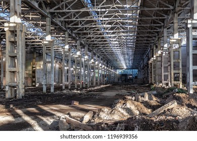 Abandoned large industrial hall with garbage. Voronezh excavator manufacturing factory.