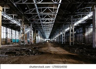 Abandoned large industrial hall waiting for demolition. Former Voronezh excavator manufacturing factory
