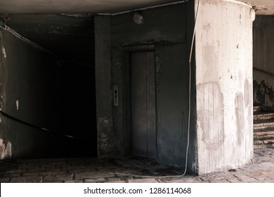 Abandoned location with elevator and staircase in concrete