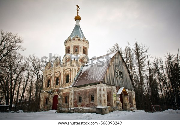 Abandoned manor of Khrapovitsky surrounded with bare trees in winter in Muromtsevo, Golden Ring in Russia
