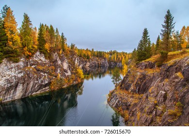 Abandoned marble canyon in the mountain park of Ruskeala, Karelia, Russia. Awesome autumn landscape.