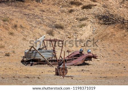 Abandoned Mining Equipment On Sapphire Gem Stock Photo (Edit