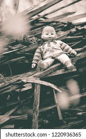 abandoned old broken baby doll rots in scary forest. Sepia Photography