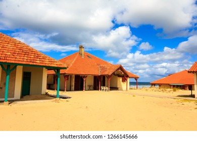 Abandoned old housed with red tiled roofs on the sandy dune over ocean in Landes, France