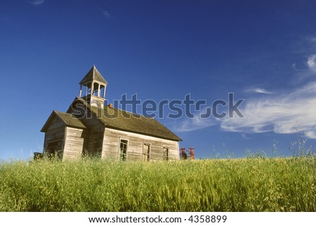 abandoned old one room school house in palouse farming region of washington state
