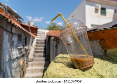 abandoned old plastic drinking cup with coffee