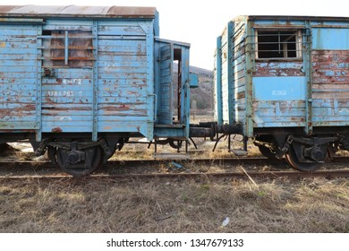 Abandoned old railway wagons at station, old train wagons in an abandoned station. Inside this train station still stay wagons since the station was closed.