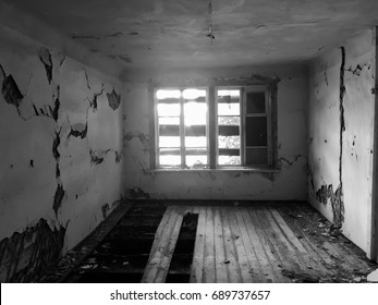 Abandoned old ruined house, a Ghost (black-and-white photo)