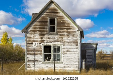 An abandoned old rustic farm house