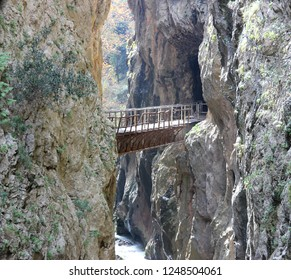 Abandoned old rusty rack railway bridge of odontotos train connecting two cliffs at vouraikos gorge  over a river at Kalavryta in Achaia Greece