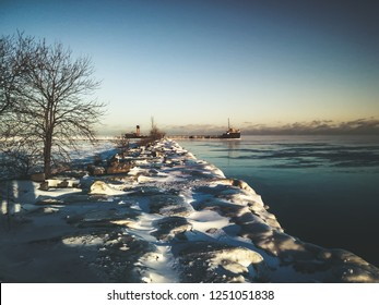 Abandoned old and rusty shipwreck during winter, Lake Ontario, Canada