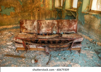 Abandoned old sofa in the factory