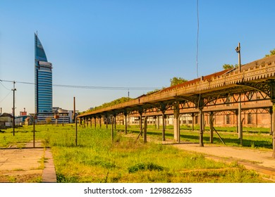Abandoned old train station with contemporary tower building at background in aguada district, Montevideo, Uruguay