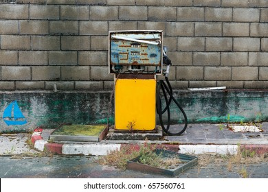 Abandoned old yellow gas pump in a secondary road in Spain