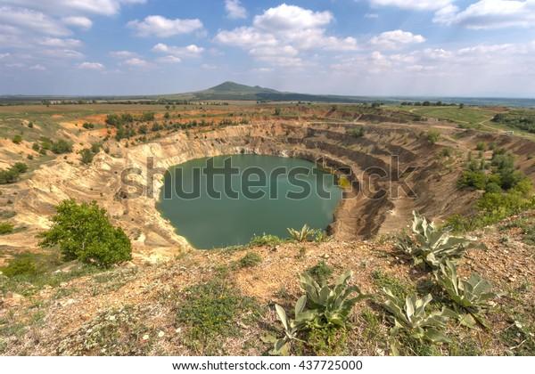 Abandoned open mine pit near Tsar Asen village in Bulgaria