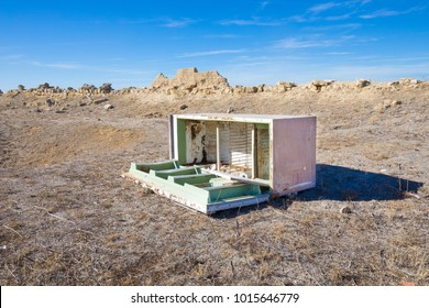 abandoned open old refrigerator in the desert countryside, in Spain, Europe