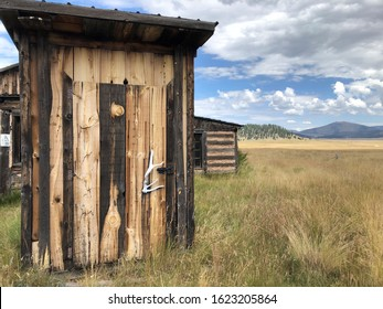 Abandoned outhouse  and cabin in Valles Caldera