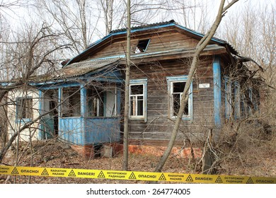 Abandoned overgrown house in Chernobyl Zone. Ukraine