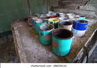 Abandoned Paint Cans in Factory