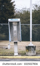Abandoned payphone box. Phone is missing.