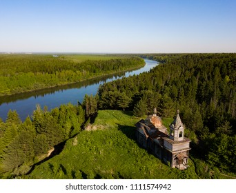 Abandoned Peter and Paul church at Nagorny Ishtan village from aerial view. Taiga forest landscape. Tomsk region, Siberia, Russia.