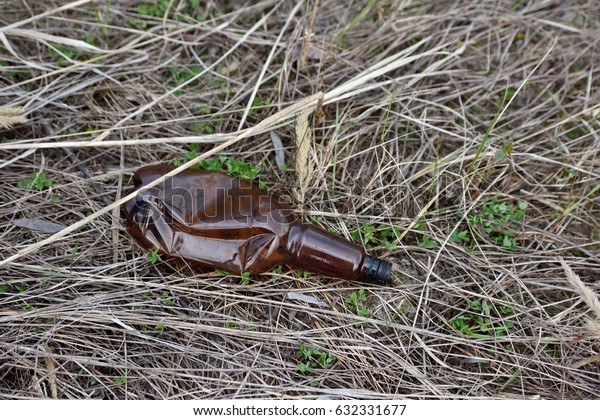 Abandoned plastic bottle on nature, pollution of nature