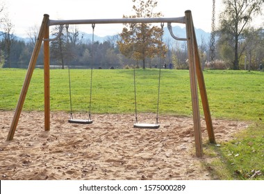 Abandoned playground with two swings in plain nature