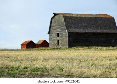 abandoned prairie barn and granaries