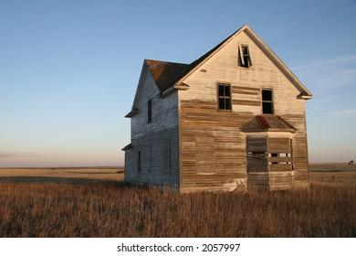 abandoned prairie farmhouse