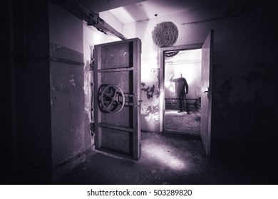 Abandoned prison in underground bunker. Ghost of prisoner. Ex Soviet cold war bomb shelter. Hermetic doors of bunker. Pipes and valves. Low light condition. Bunker of fear and nightmares.