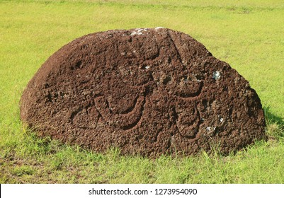 Abandoned Pukao or Moai Statue's Topknot with the Petroglyph on Red Scoria Stone at Puna Pau Volcano, Archaeological site of Easter Island, Chile