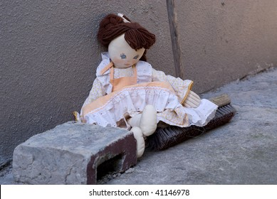 Abandoned rag doll, left in the dirt