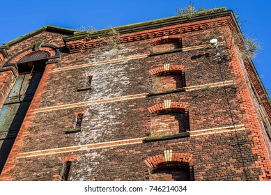 Abandoned red brick dock warhouse in Liverpool.