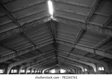 Abandoned roof of pigsty space background. gray concrete warehouse interior.