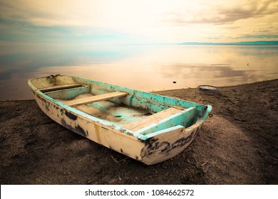 abandoned row boat along shore on Salton Sea in the California Desert