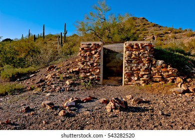 An abandoned ruin of what appears to be a storage room built out of rocks. Located near the Tonopah Belmont Mountain Mining Camp. The mining camp was founded in the late 1860s and closed in 1942.