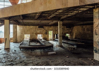 Abandoned ruined by war international airport terminal