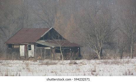 Abandoned and ruined house in winter,
