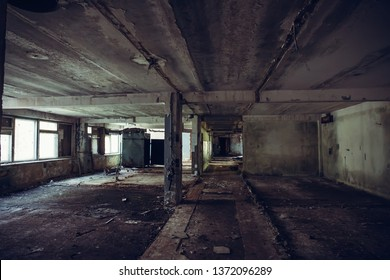 Abandoned ruined industrial building room inside interior, dark dirty grunge and creepy atmosphere, toned