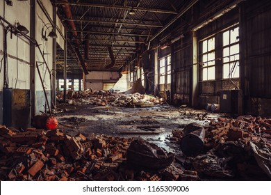 Abandoned ruined industrial warehouse or factory building inside, corridor view with perspective, ruins and demolition concept, toned