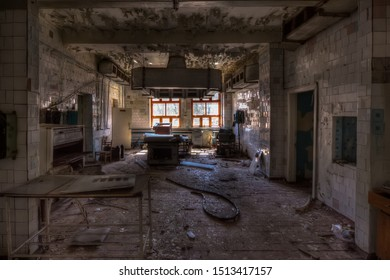 Abandoned and ruined kitchen of closed factory canteen or restaurant.