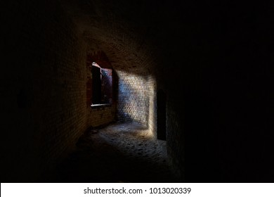 Abandoned ruins of fortifications. Legacy of World War. Brick wall. Light from window.