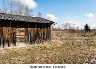 Abandoned ruins of old wooden building in latvia countryside