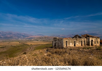 Abandoned ruins of rural house in South Albania in autumn time. Vlora district, not far from Saranda