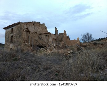 An abandoned and rumbled brick made country house during evening in the rural area of Zaragoza, Aragon region, Spain