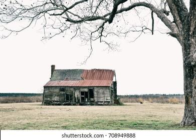 An Abandoned Run Down Farmhouse in a Field