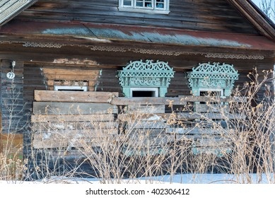 Abandoned rural wooden house with boarded up windows in Russia