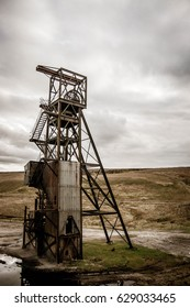 Abandoned rusted mining control tower in an urban area
