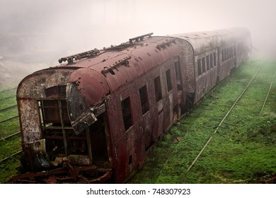 Abandoned rusting train and empty train tracks photographed in a foggy day in the village of Paranapiacaba, Sao Paulo, Brazil.
