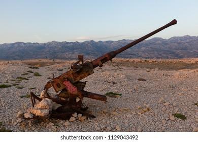 Abandoned rusty canon on Croatian coast at Paklenica Canyon, Croatia
